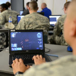 Sgt. 1st Class Scott Blakey assess weapons systems for Team Kobayashi Maru during the 780th Military Intelligence Brigade's Cyber Capture the Flag exercise at McGill Training Center on Fort George G. Meade, Md., May 19, 2015. (DOD photo by Jacqueline M. Hames, Soldiers, Defense Media Activity)