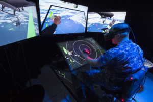 150914-N-PO203-092 SAN DIEGO, California (Sep. 14, 2015) Lt. Jeff Kee explores the Office of Naval Research (ONR)-sponsored Battlespace Exploitation of Mixed Reality (BEMR) lab located at Space and Naval Warfare Systems Center Pacific. BEMR is designed to showcase and demonstrate cutting edge low cost commercial mixed reality, virtual reality and augmented reality technologies and to provide a facility where warfighters, researchers, government, industry and academia can collaborate. (U.S. Navy photo by John F. Williams/Released)